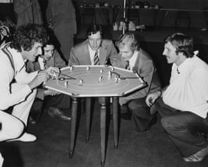 England test cricketers enjoy a game of table cricket at Lords in London, before leaving for the winter tour of Australia in October 1978. From left to right, they are Bob Willis, Derek Randall, Mike Hendrick, David Gower and Ian Botham.