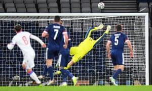 Scotland's goalkeeper Craig Gordon acrobatically saves a shot from Faroe Islands' midfielder Brandur Hendriksson (left).