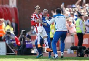 Shaqiri jumps onto manager Paul Lambert.