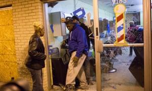 Business owners survey damage during rioting in Ferguson