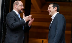 Greek Prime Minister Alexis Tsipras (rigt) and European Parliament President Martin Schulz share a joke outside the Greek Premier's office in Athens today.