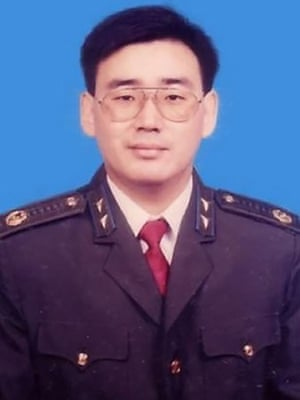 Yang Hengjun in the uniform of the Chinese state security police