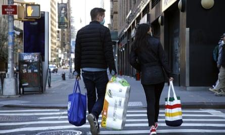 Shoppers walk on 7th Avenue, New York.