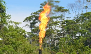 A flame flares at the oil production facility on the border of the Yasuní national park in Ecuador