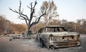 A burned car sits in the driveway of a home just north of Ukiah, California.