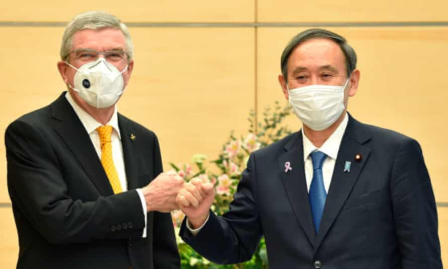 International Olympic Committee president Thomas Bach (L) meets Japan's prime minister, Yoshihide Suga, in Tokyo.