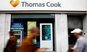 Shoppers pass a closed-down Thomas Cook store in London.