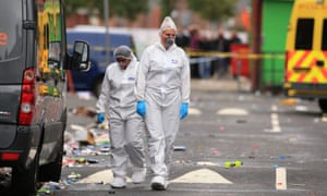 Forensics officers examine the scene in Claremont Road