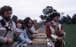 Stanley Kubrick (third left) during a break in filming on one of the battlefield scenes on location in Ireland, with actor Ryan O'Neal (right). Kubrick's teenage daughter Vivian is next to the director. Jan Harlan: 'Stanley loved Barry Lyndon. He loved this upstart from nowhere, a conman, and he felt very strongly that Barry was representative of our society. What you see here is the normal sort of track they would lay down to move the camera – there was no Steadicam in those days. You had to be careful to point the camera in the right direction, otherwise you would film the track itself'