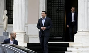 Greek prime minister Alexis Tsipras leaves his office in Maximos Mansion after a meeting with his government's financial staff.