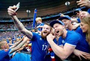 Iceland's Aron Gunnarsson celebrates with a selfie
