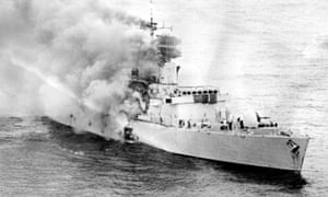 Smoke billows from HMS Sheffield after it was hit by an Exocet missile in 1982.