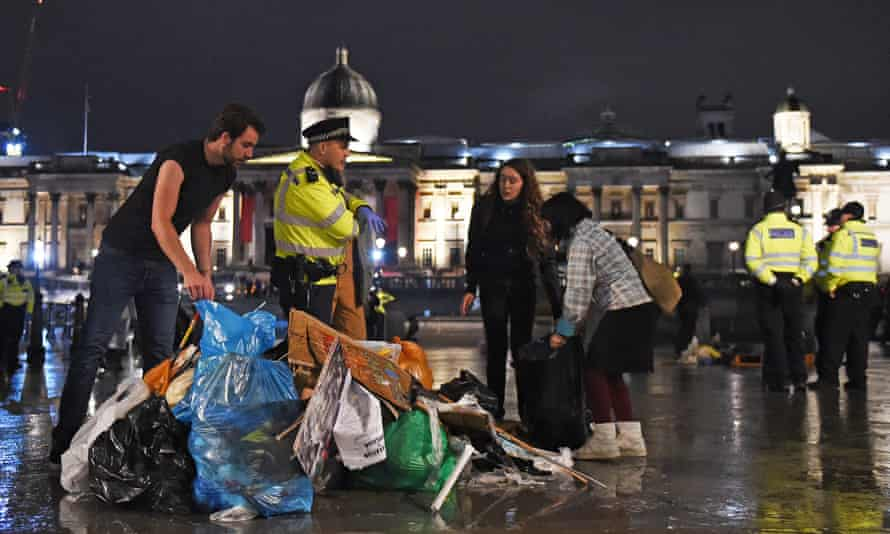 Protesters gather their belongings as police remove the last of the Extinction Rebellion demonstration in Trafalgar Square.