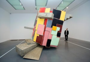 London, England: A member of staff looks at Phyllida Barlow's 'untitled: upturned house, 2'