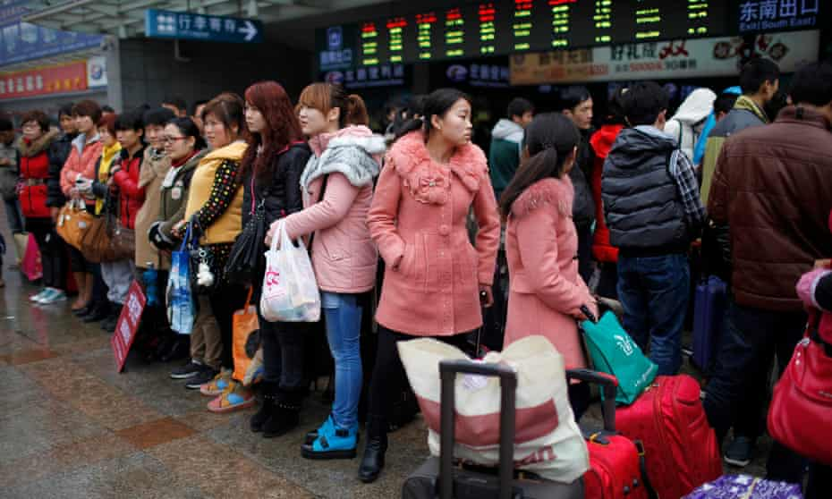 Migrant workers at Shanghai railway station. An account of their struggles by budding writer Fan Yusu has gone viral but she has 'no idea' why.