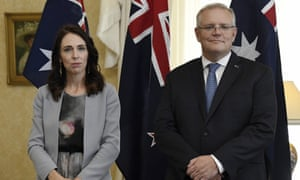 New Zealand Prime Minister Jacinda Ardern, left, stands with Australian Prime Minister Scott Morrison during the signing of the Indigenous Collaboration Arrangement at Admiralty House in Sydney, Friday, 28 February 2020.