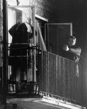 A member of the IRA surrenders to police at a flat at 22b Balcombe Street in Marylebone, London, at the end of the Balcombe Street Siege, 13 December 1975