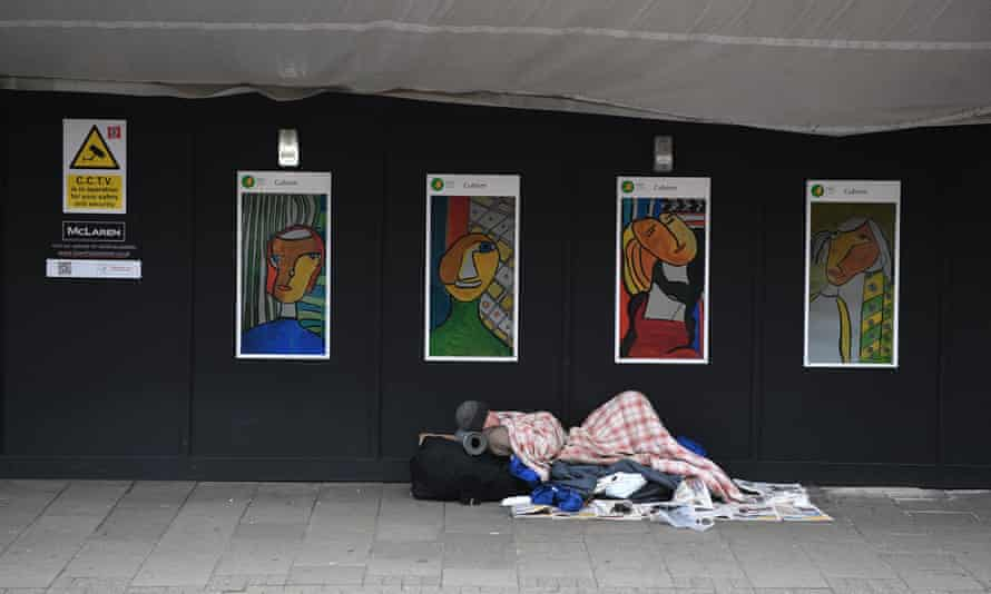 A homeless man sleeps near King's Cross in London, Britain.