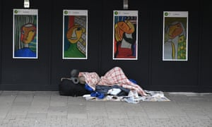 A homeless man sleeps near King's Cross in London.