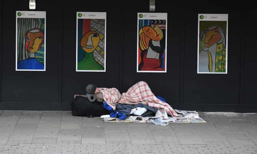 A homeless man sleeps near King's Cross in London.