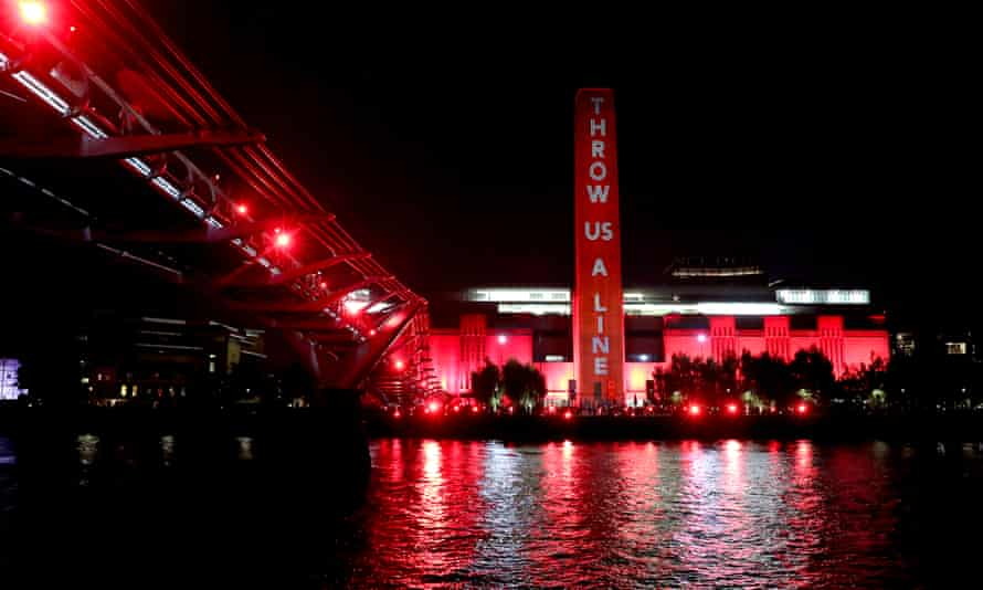 The Tate Modern in London lit up in red