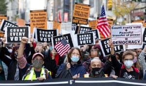 Demonstrators march one Fifth Avenue during a rally for ensuring that every ballot is counted in the 2020 Presidential election in New York, New York USA, 04 November, 2020. Counting of mail-in/absentee ballots in several states began on 03 November and is expected to stretch as far as 06 November.