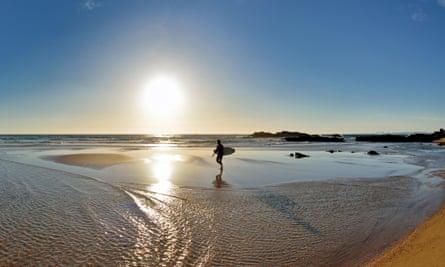 Life's a beach … surfer in the Alentejo, Portugal.