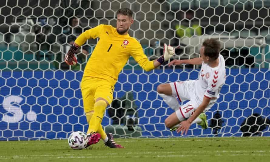 Czech Republic goalkeeper Tomas Vaclik clears the ball away from Danish challenge Mikkel Damsgaard.