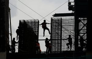 Jakarta, IndonesiaThe silhouette of Indonesian laborers work on a construction site in Jakarta.