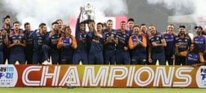 Suryakumar Yadav and Ishan Kishan of India lift the trophy.