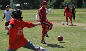 Afghanistan's women's team take part in a training session at a military club in Kabul in 2010.