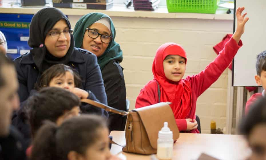Parents join pupils in a 'No Outsiders' session at Parkfield community school in Birmingham.