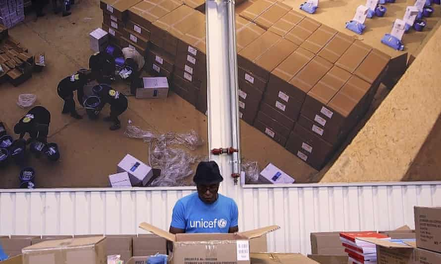 people working inside the UNICEF warehouse, the world's largest humanitarian aid warehouse, in Copenhagen