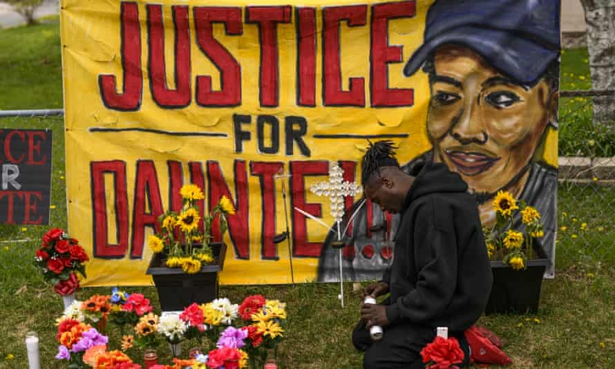 Antwon Davis lights candles at a memorial for Daunte Wright on 2 May in Brooklyn Center, Minnesota.