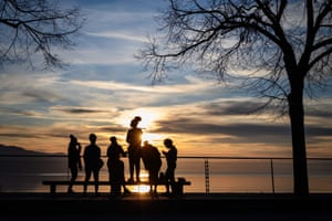 Youngsters gather at sunset above the town of Montreux on Lake Geneva, Switzerland