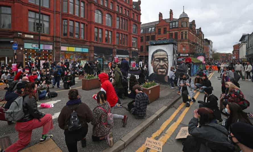 Black Lives Matter protesters take a knee during a protest in St Peter's Square, Manchester, on Saturday