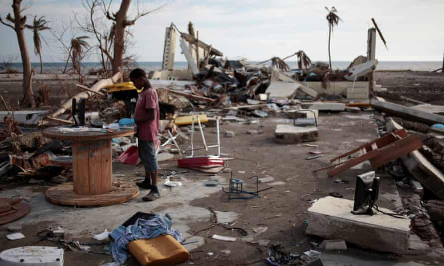 A boy plays in a building destroyed by hurricane Matthew in Coteaux, Haiti.
