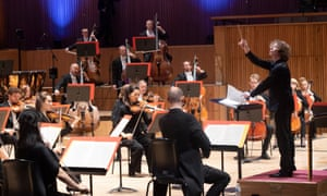 Santtu-Matias Rouvali conducts the Philharmonia Orchestra at the Royal Festival Hall, London.