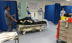A suspected drunk man is brought into the assessment area of an NHS hospital