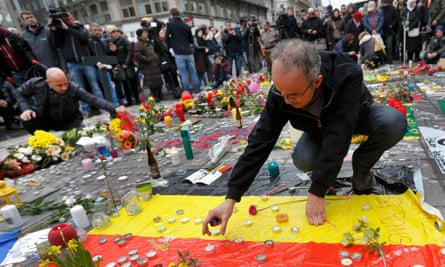 Candles are placed at a street memorial on Wednesday following the attacks in Brussels.