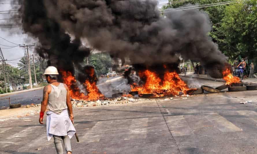 Smoke rises from roadblocks in Hlaing Tharyar township in Yangon
