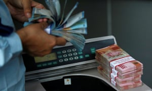 Indonesian rupiah banknotes are counted at a money changer in Jakarta, Indonesia.