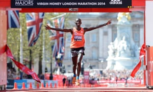 Wilson Kipsang crosses the line to win the 2014 London Marathon.