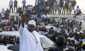 President Adama Barrow rides through crowds of supporters after arriving at Banjul airport in Gambia in January