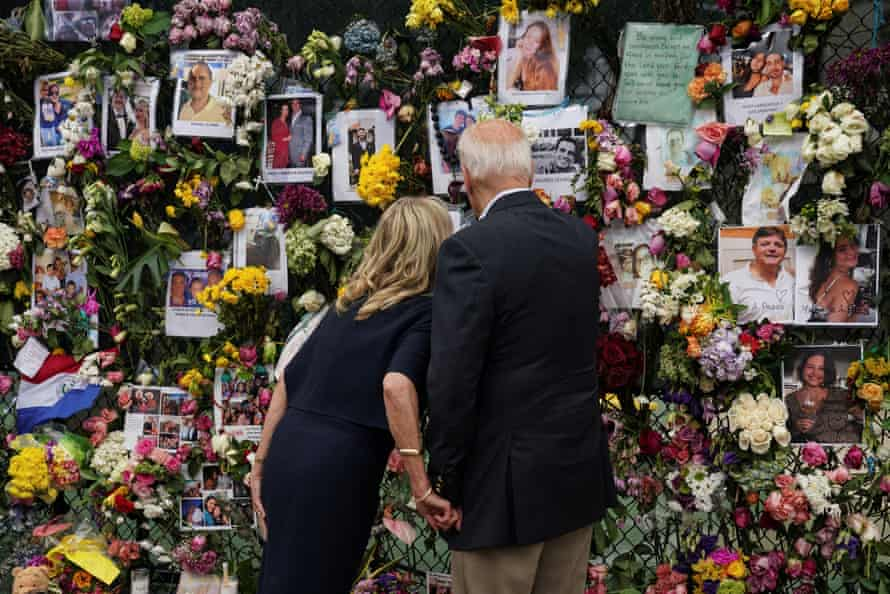 Joe Biden and first lady Jill Biden visit a memorial put in place for the victims of the building collapse.