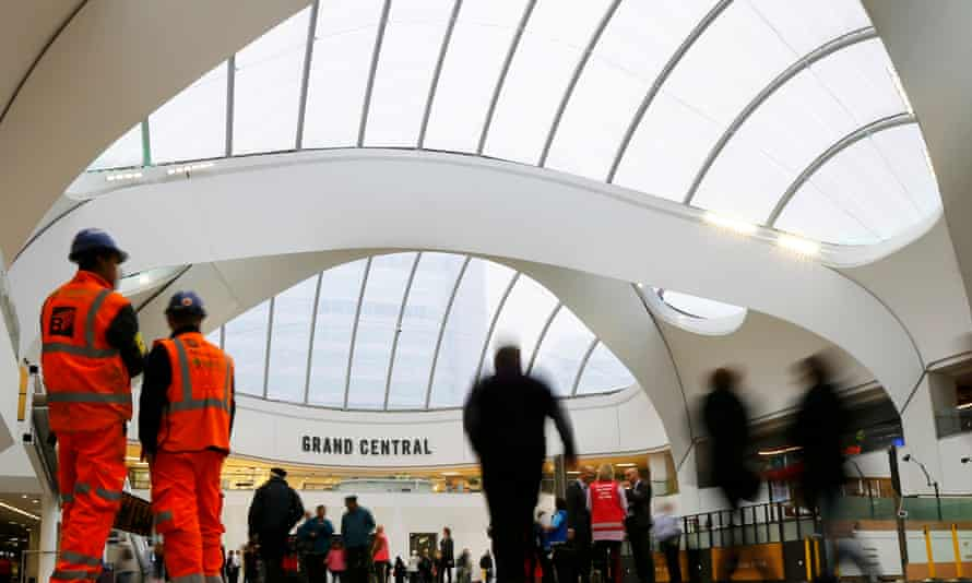 Passengers walk through the concourse at New Street station in Birmingham.