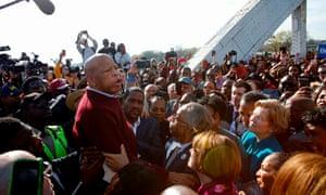 Pete Puttigieg, Al Sharpton and Elizabeth Warren listen to John Lewis speak as they march march during the Annual Bloody Sunday March across the Edmund Pettus Bridge in Selma