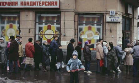 People queue on an icy Moscow street to buy bread.