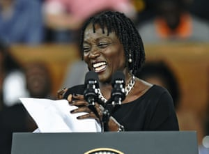Obama's sister Auma introduces him at the Moi international sports centre in Nairobi.