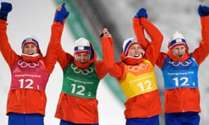 Norway's ski-jumpers celebrate a team gold medal.